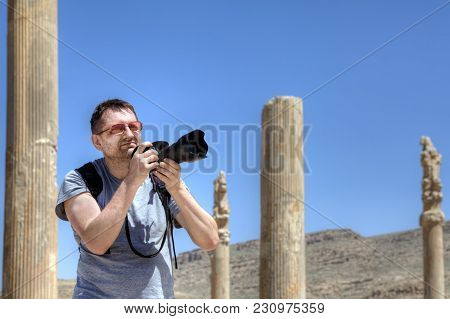 Solo Travel In The Middle East, An Independent Tourist On An Individual Trip Photographs The Ruins O