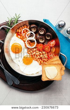 Full English Breakfast With Fried Eggs, Beans, Toasts, Tomatoes , Mushrooms