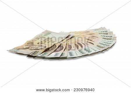 1000 Bath Thai Banknotes Isolated On White Background. Banknote Exchange In Thailand