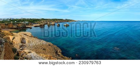 Summer Atlantic Coast Landscape With Rock Formations Near Beach Praia Dos Arrifes And Praia Da Vigia