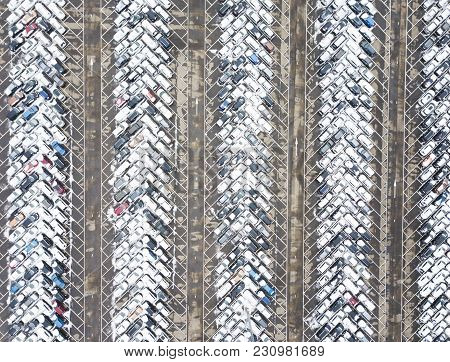Large Car Parking. Aerial View. Industrial Background. Snow