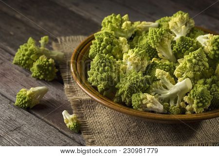 Plate Filled With Fresh Romanesco Broccoli Placed On A Rustic Wooden Table. Selective Focus