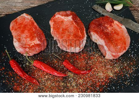 Preparing A Steak For Grilling With An Overhead View Of A Lean Steak Seasoned With Spice And Herbs R