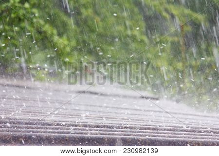 Summer Rain With Hail Falls On The Roof Of Slate