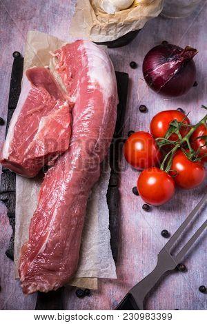 Whole Pork Tenderloin Meat On Wooden Vintage Board