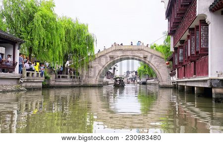 July 5, 2015.  Shanghai, China.  Chinese Tourists On The Many Bridges And Boats On The Water Canals