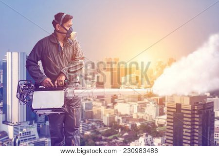 Man Fogging To Eliminate Mosquito For Preventing Spread Dengue Fever And Zika Virus In The City Back