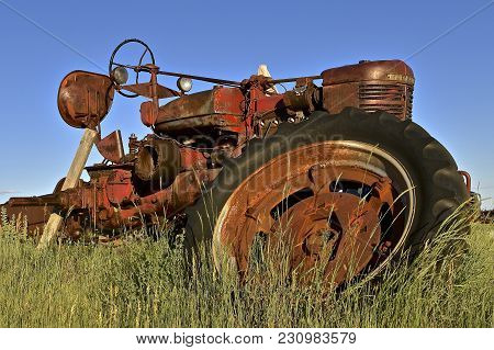 Firesteel, South Dakota, June 23, 2017: The Old  M Farmall Tractor Was A Model Name And Later A Bran