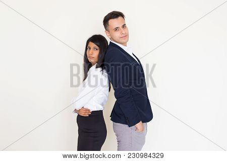 Portrait Of Confident Young Multiethnic Team, Indian Businesswoman And North American Businessman, S