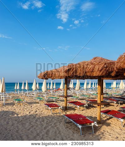 Morning Paradise White Sandy Beach Maldives Of Salento With Sunshades And Sunbeds (pescoluse, Salent