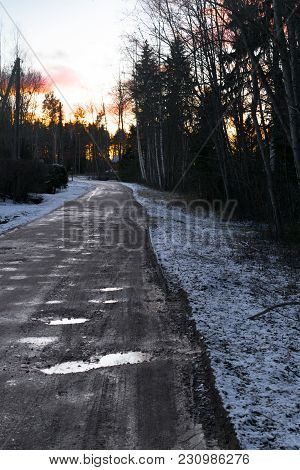 Beautiful Winter Landscape Wit Road To Sunset. Dirty Bad Road.