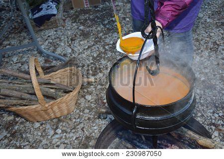 Cauldron,caldron With Hot Soup On A Christmas Market