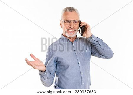 Cheerful mature man in eyeglasses talking on smartphone while posing isolated over white