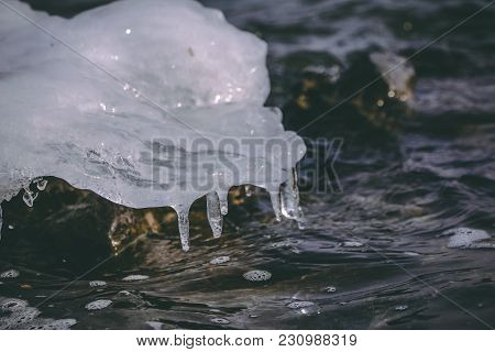 Frozen Water Drops On Top Of Non Frozen Water