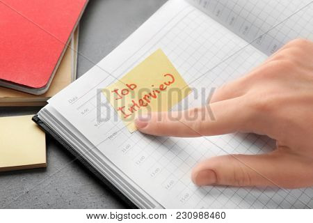 Woman pointing at note with words