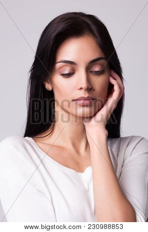 Sad Depressed Young Woman Wearing White Coat With Hand Near Her Fase Isolated On White Background