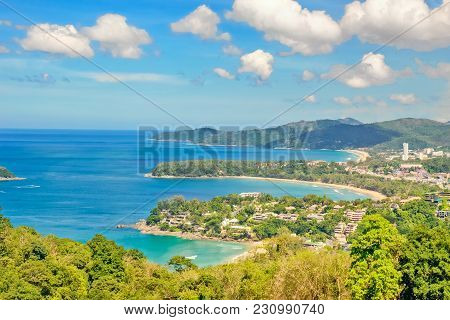 Landscape With Turquoise Sea, Beaches, Tropical Greenery On The Background Of Blue Sky With White Cl