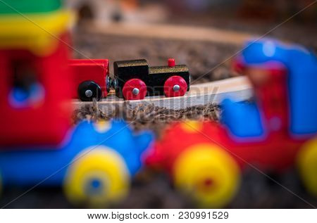 Colourful Wooden Toy Train On The Carpet In The Living Room In The House