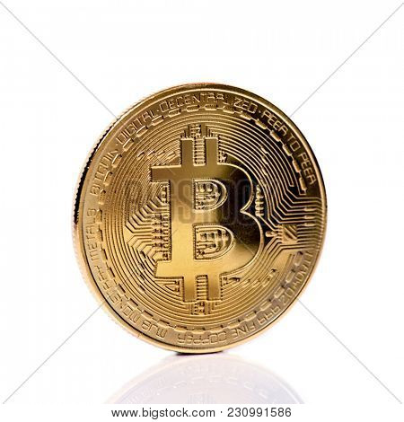 closeup of a bitcoin on a white background