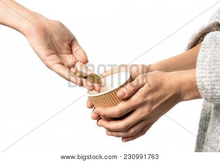 Woman putting coins into cup in hands of female beggar, isolated on white