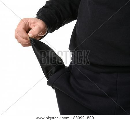 Poor man showing empty pocket on white background