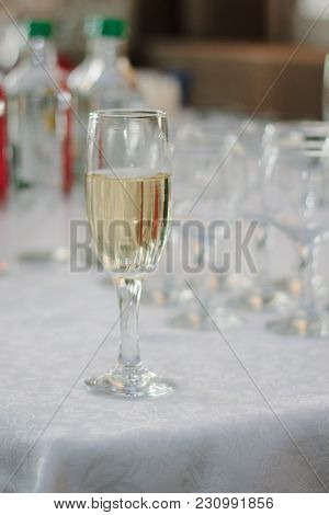 Glass Filled By Fresh Champagne On Restaurant