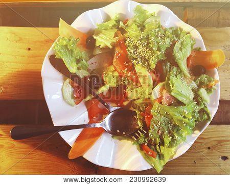 Salad. Fresh Summer Lettuce Salad.healthy Mediterranean Salad On Wooden Table. Vegetarian Food.