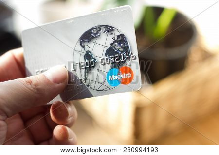 Ryazan, Russia - February 27, 2018: Hand Holds Maestro Card