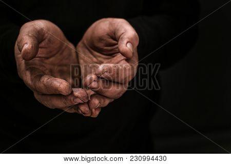 Poor man begging for money on dark background