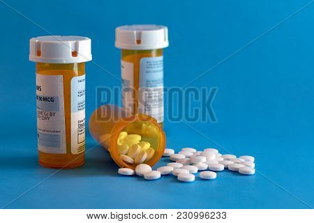 Open Bottle of Prescription Drugs on white with space for text