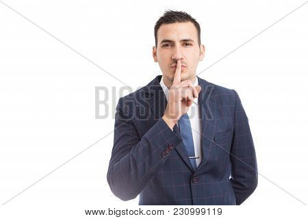 Sales Man Or Broker Touching Lips As Shush Gesture.