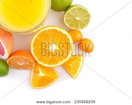 Exotic Flat Lay. Orange Juice With Exotic Citrus Fruits Around. Refreshing Orange Juice . Exotic Mix