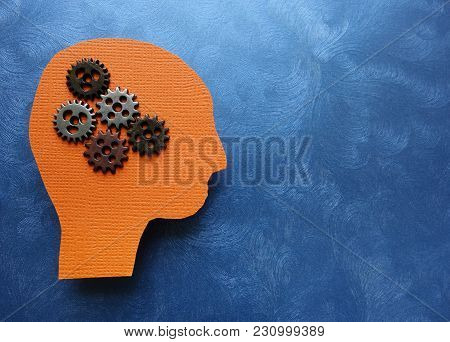 Gears And Paper Head Cutout On Blue Textured Background