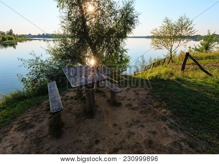 Picturesque Summer Evening Sunset Lake View With Camping Pitch On Shore And Wood Stairs To The Water