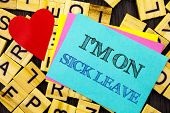 Handwritten text showing I m am On Sick Leave. Conceptual photo Vacation Holiday Absent Out Of Office Sickness Fever written colorful sticky note the letter background Love Heart for Loving poster