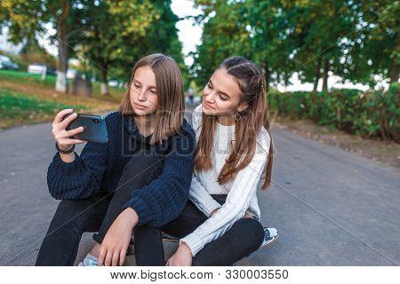 Two Girls Schoolgirls Teenagers 12-15 Years Old, Autumn Day Summer City Park, Smartphone, Selfie Pho
