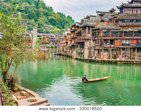 Unacquainted Local Chinese People On The Boat In Fenghuang Old Town.phoenix Ancient Town Or Fenghuan