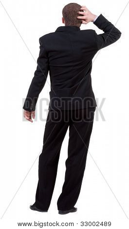 Back view of thinking business man. gesticulating adult businessman in black suit . Rear view people collection.  backside view of person.  Isolated over white background.
