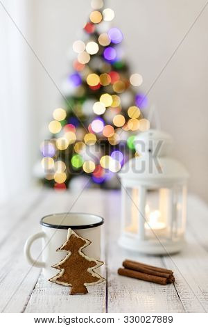 Merry Christmas! White Candlestick Flashlight Stands On The Background Beautiful Blurred Christmas T