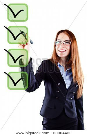 Portrait of a young beautiful  business woman checking on checklist boxes