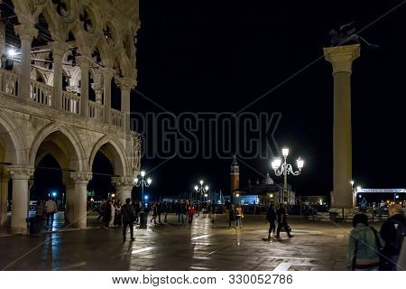 Venice, Italy - May 19, 2017: People Walk On St Mark`s Square In Venice City At Night. San Marco Is