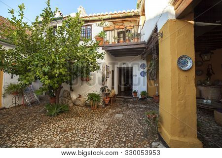 Comares, Spain - Sept 23th, 2018: Courtyard Of Molino De Los Abuelos Hotel, Built With Typical Axarq