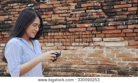 Young Tourist Woman Visiting Attractions And Taking Photos On Holiday - Diverse Asian Lifestyle Infl
