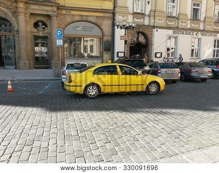 Yellow Taxi Car In Prague