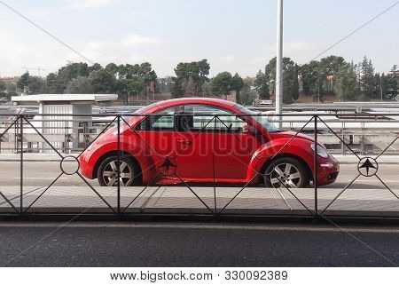 Madrid, Spain - Circa October 2017: Red Volkswagen New Beetle Car Parked In A Street Of The City Cen
