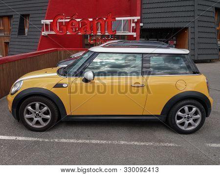 Briancon, France - Circa August 2019: Yellow Mini Cooper Car Parked