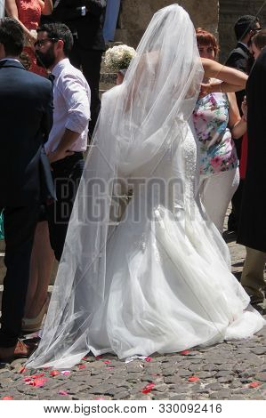 Coimbra, Portugal - Circa June 2015: Bride, Groom And Wedding Guests In Front Of The Church Se Velha