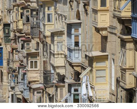 Valletta, Malta - Circa May 2019: Xviii Century Wooden Balconies In Republic Street