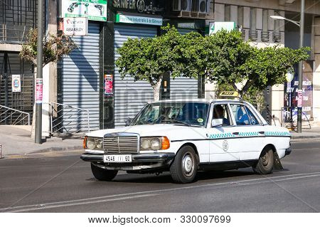 Casablanca, Morocco - September 29, 2019: Old Taxi Car Mercedes-benz E-class (w123) In The City Stre
