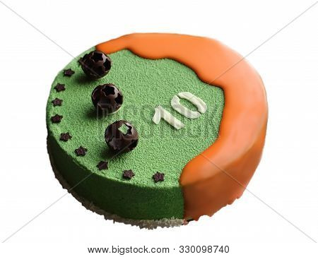 Orange And Green Round Cake With Chocolate Football Decorations And Whiite Chocolate Number Ten On W